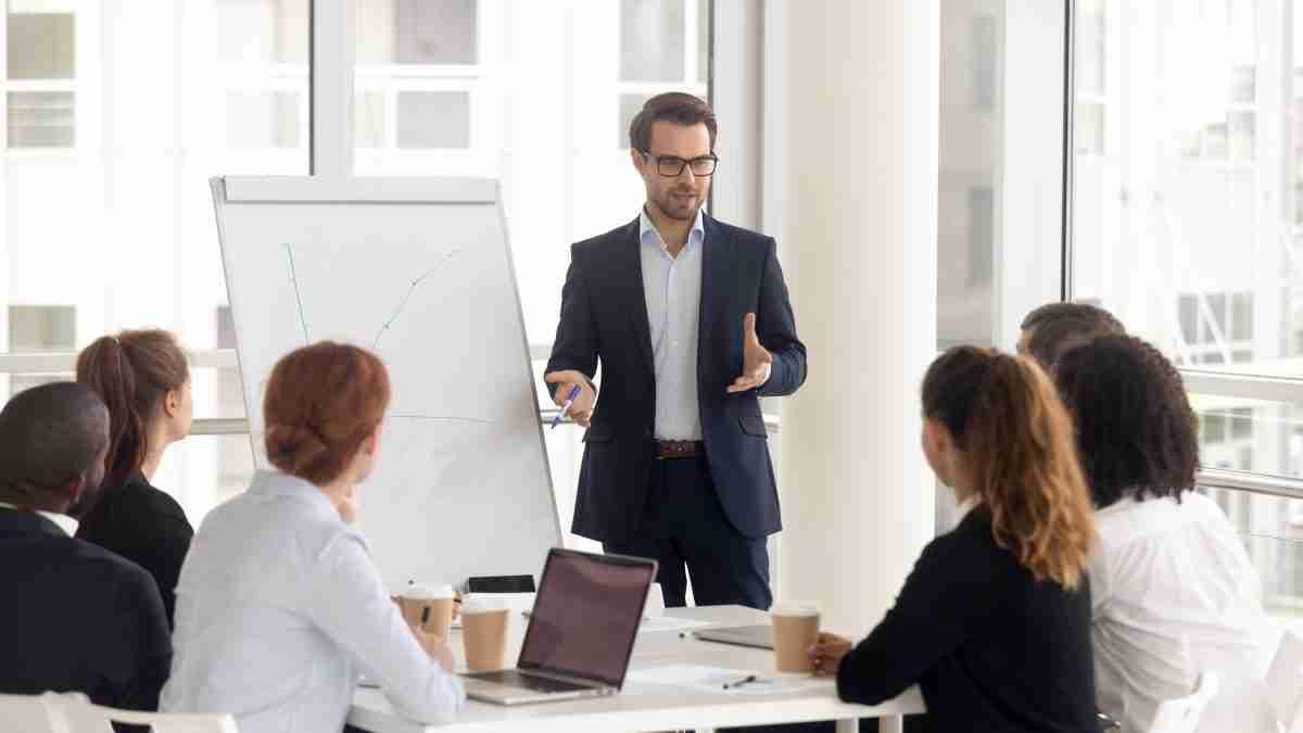 Male business coach speaker in suit give flipchart presentation